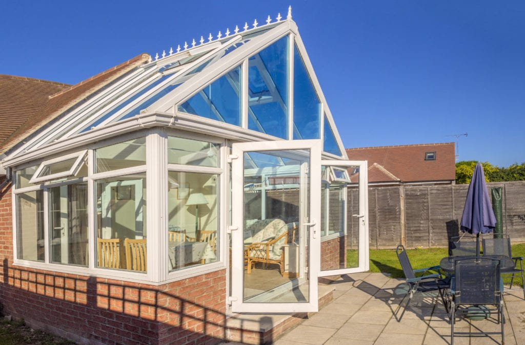 Picture of a conservatory with patio, doors open